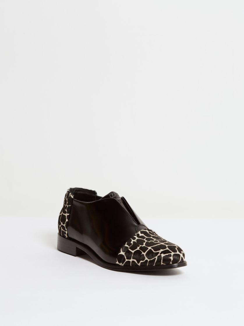 Kingsley Sintra Shoes uragano black, giraffe front view